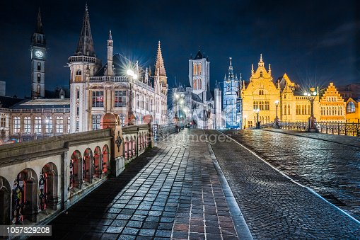 Panoramic view of the historic city center of Ghent illuminated in beautiful post sunset twilight during blue hour at dusk, Ghent, East Flanders, Belgium