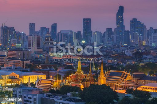 Twilight view of Grand palace and Wat phra keaw or Emerald Buddha temple with Bangkok downtown
