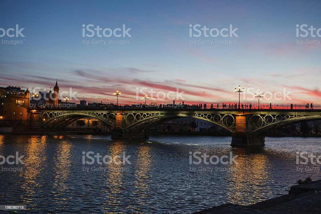 Twilight view of Isabel II Bridge in Seville, Spain royalty-free stock photo