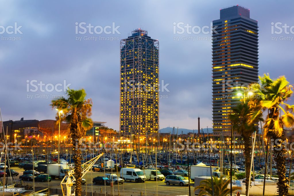 Twilight view of skyscrapers from port stock photo