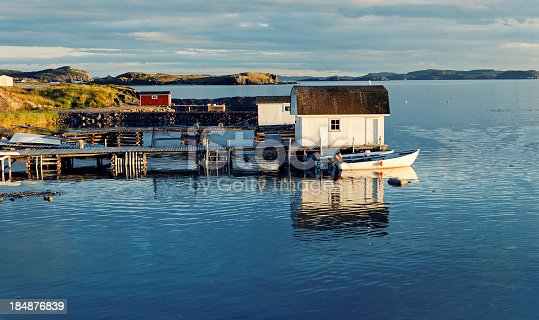 Picturesque fishing  village in Newfoundland,Canada. Known as ' Iceberg capital of the world '. Many icebergs, calved in Greenland, can be seen from the shore in early summer. Picture taken in an eraly morning light.