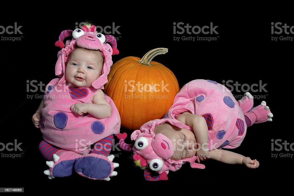 twin baby girls in halloween costumes royalty free stock photo
