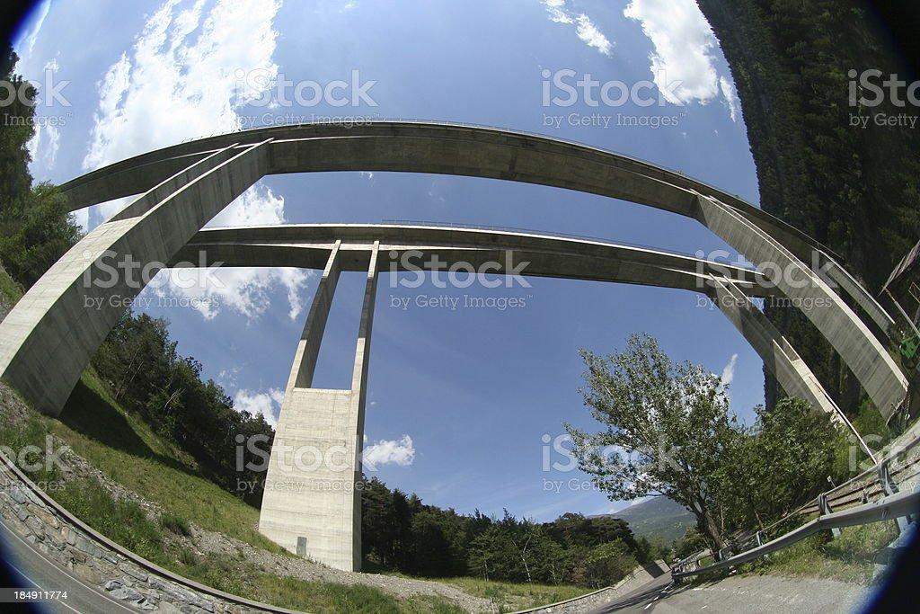 Twin bridge crossing a valley in Italian Alps royalty-free stock photo