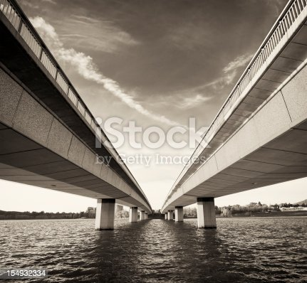 The modern concrete bridges over the cold water of Lake Burley Griffin in Canberra, Australia.