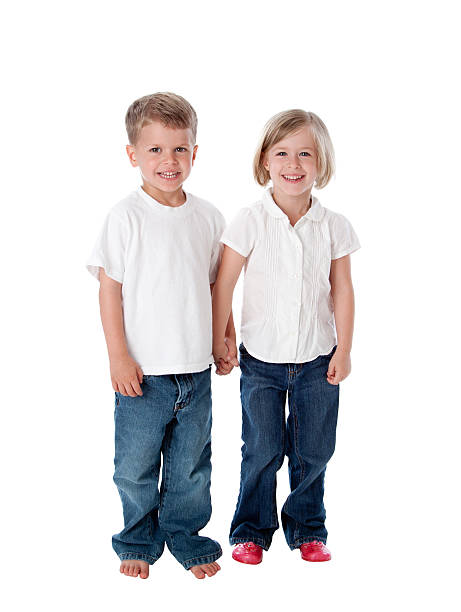Twin Brother and Sister Children Holding Hands Full Length stock photo