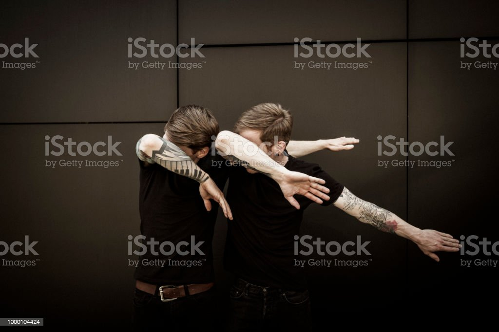 twin brothers doin the dab dance figure royalty-free stock photo