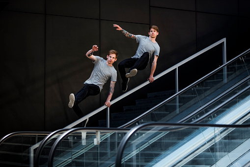 istock twin brothers doing urban parkour 978397832