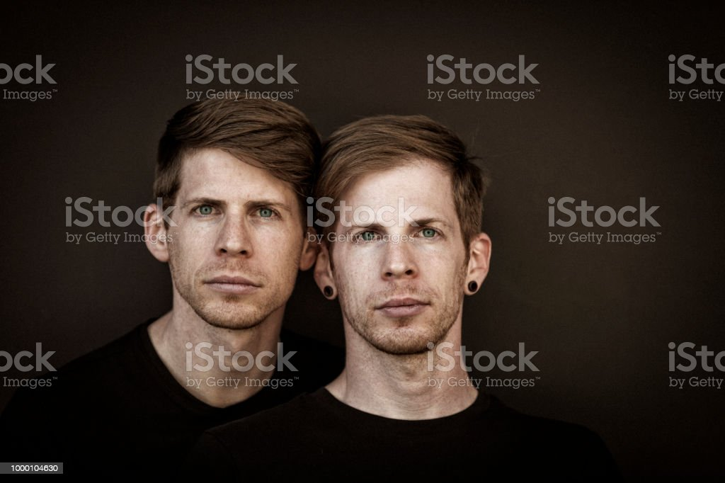 twin brothers portrait stock photo