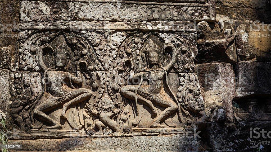 Twin Dacing Apsara in Bayon Temple stock photo