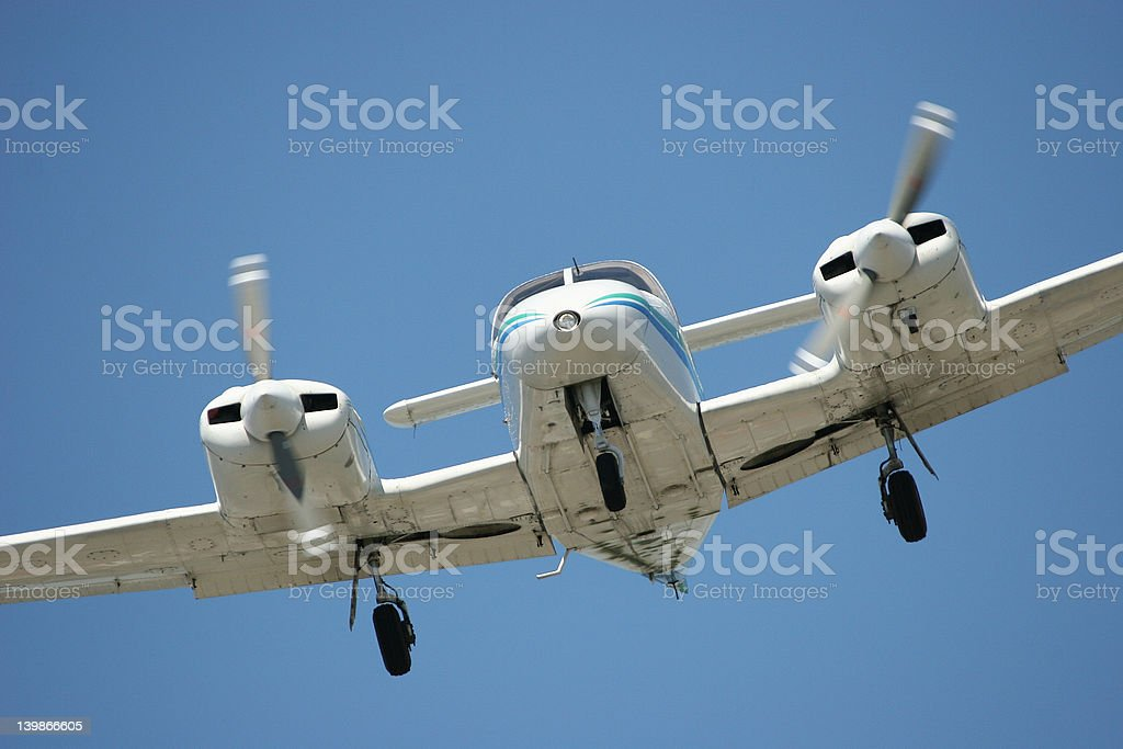 Twin engine airplane landing stock photo