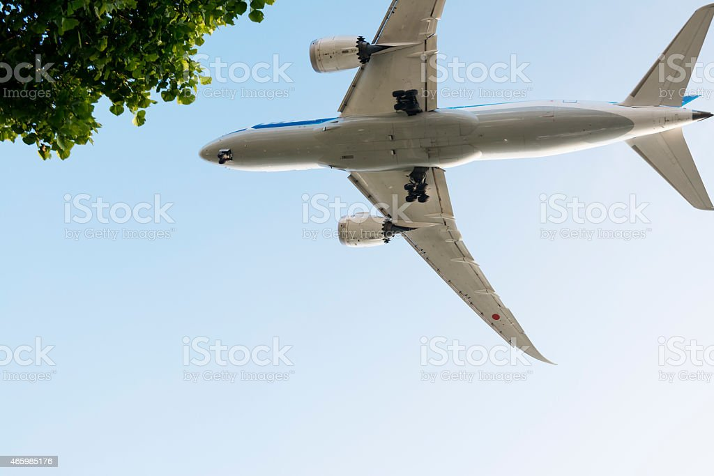 Twin engine passenger jet flying overhead stock photo