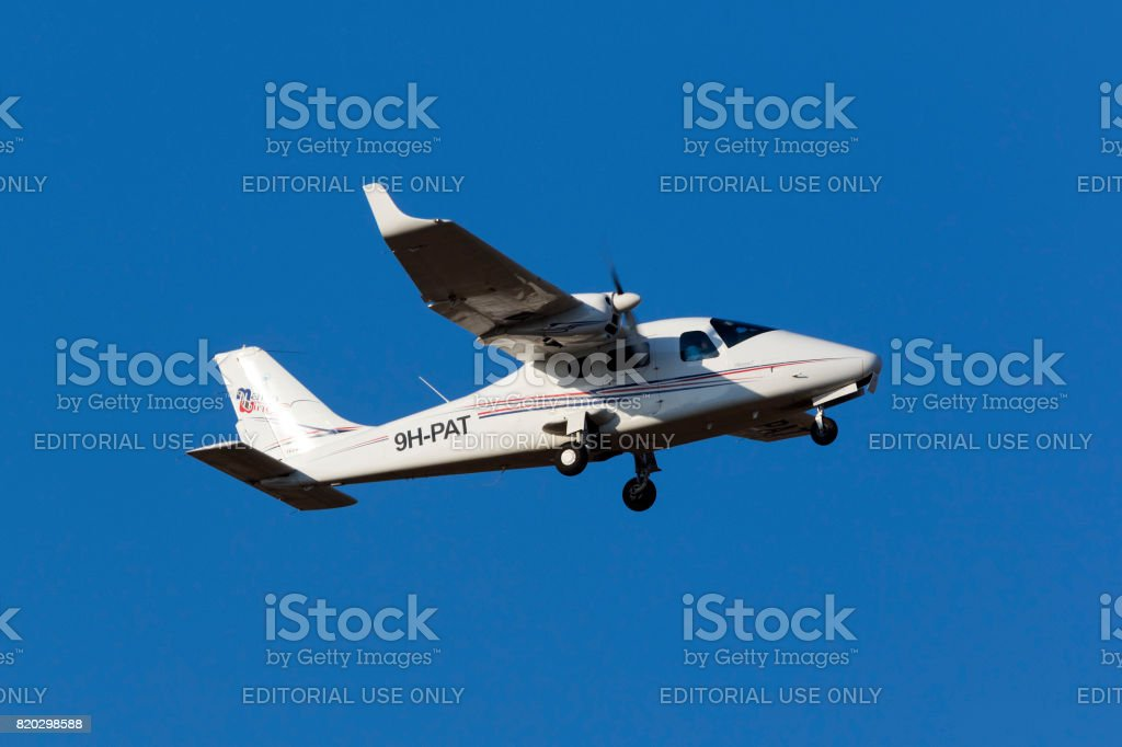 Twin engined light plane on pilot training flight stock photo