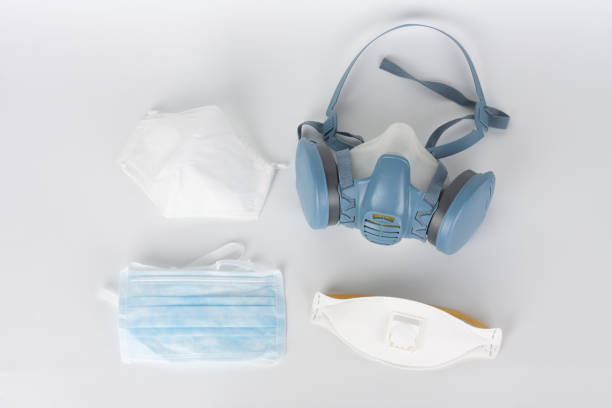 twin filter half face respirator mask ffp3 , respirator ffp1, ffp2 and face mask, personal protective equipment to protect against the virus covid-19. - ffp2 imagens e fotografias de stock