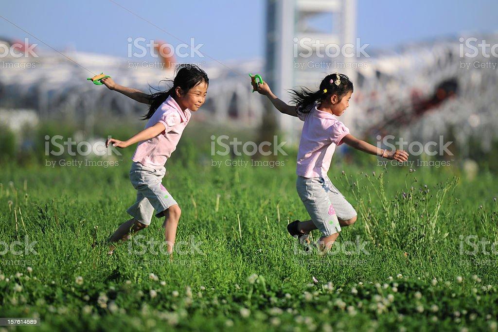 Twin Girls Free Running  - XLarge stock photo
