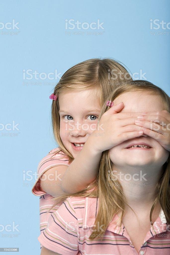 Twin girls playing royalty-free stock photo
