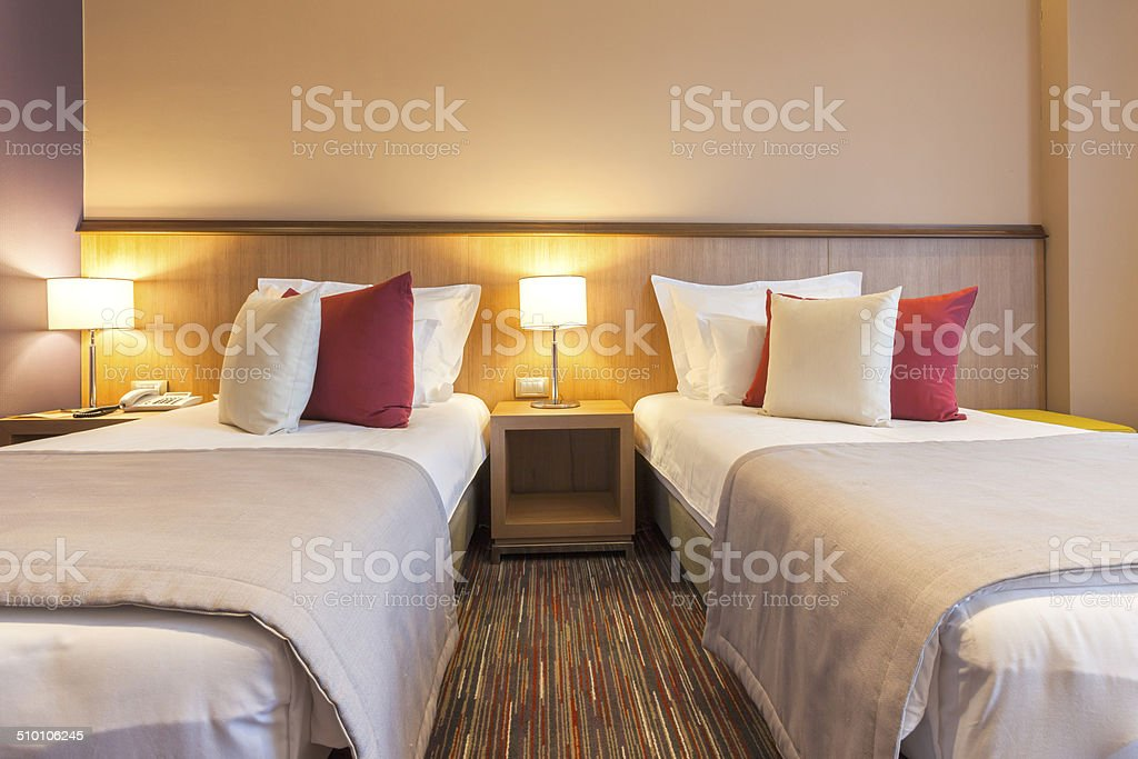 Twin hotel room interior stock photo