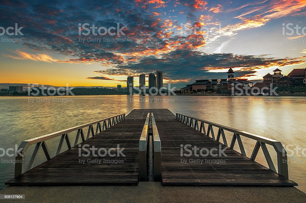 Twin jetty / dock with a nice sunset / sunrise stock photo