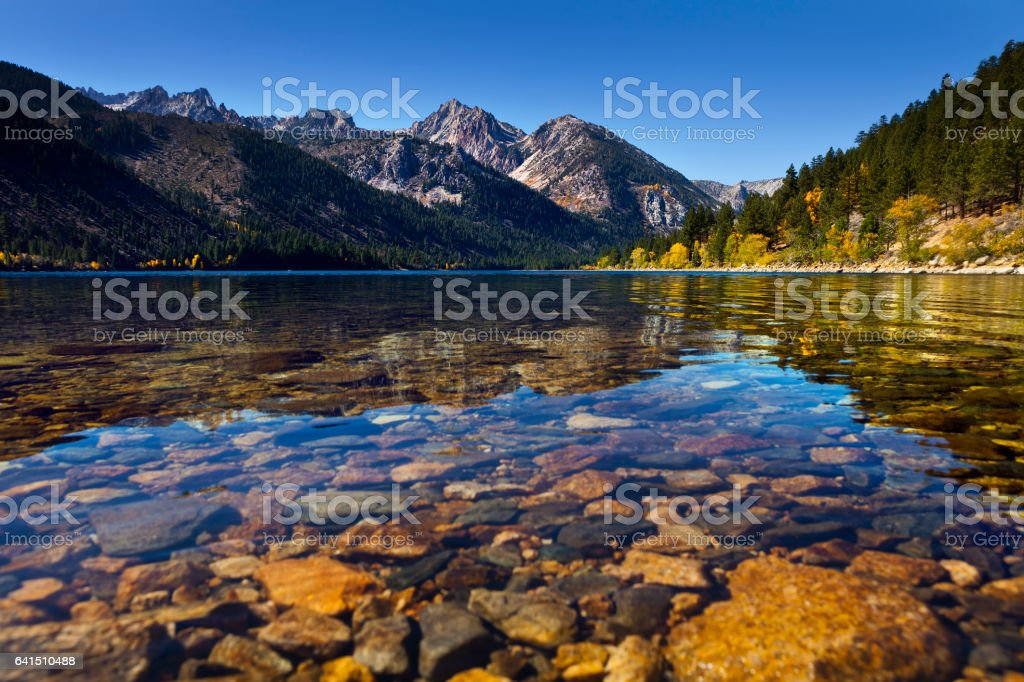 Twin Lakes near Bridgeport, CA. Mountain lake with reflections and clear water showing the rocks beneath. stock photo