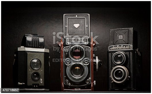 Vancouver, Canada - March 15, 2015: Twin lens reflex (TLR) style vintage film cameras on display. Cameras include a Kodak Brownie Reflex, Rolleiflex 3.5F and soviet-made Lubitel-2.