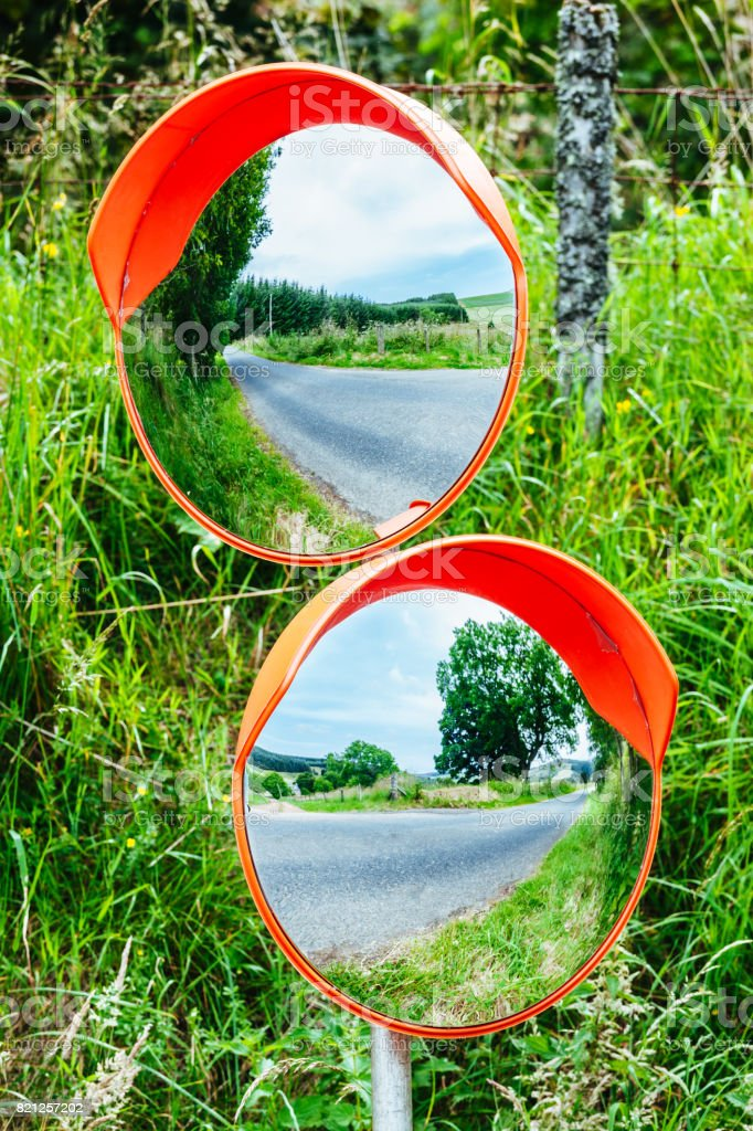 Twin road mirrors for road safety stock photo