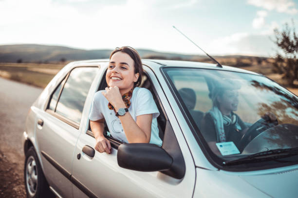 Twin sister having a road trip on a sunny summer day stock photo