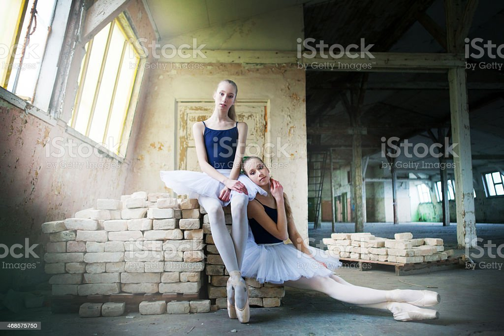 Twin sisters ballet dancers stock photo