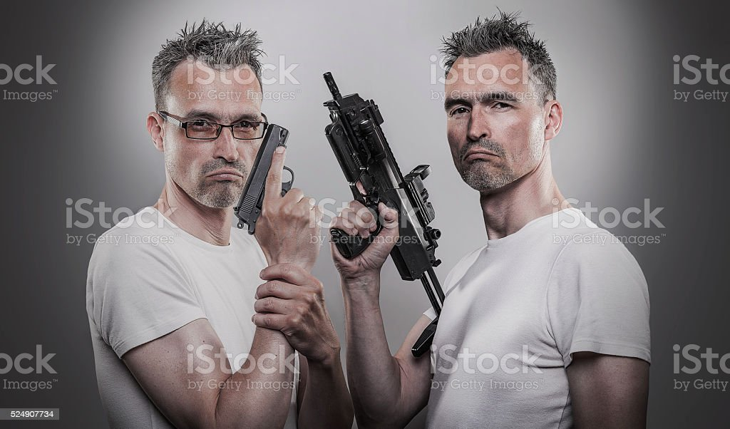 Twin soldiers with guns posing stock photo