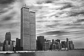 Twin Towers NYC in foreground. Archival and historical cityscape of New York skyline from Hudson River with World Trade Center. Lower Manhattan in NYC, United States. Vintage shot in black and white.