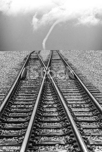 Composite image of railroad tracks and tornado cloud. Colorado.