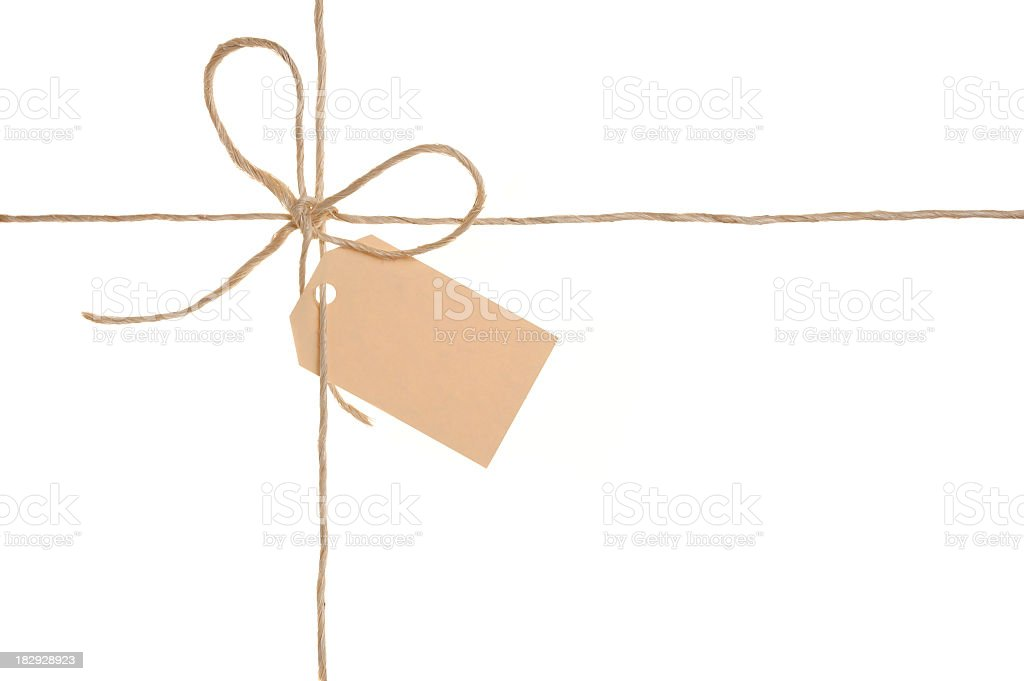 Twine package bow with brown label royalty-free stock photo