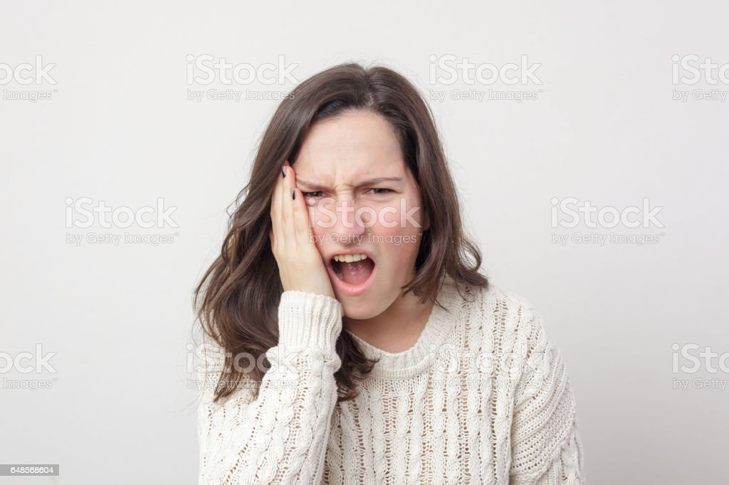 Twinge of toothache stock photo