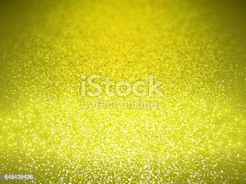 645448998 istock photo twinkling golden glitter background with a spotlight and depth of field and bokeh effect 645439436