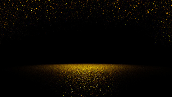 istock twinkling golden glitter falling on flat surface lit by spotlight 609708620