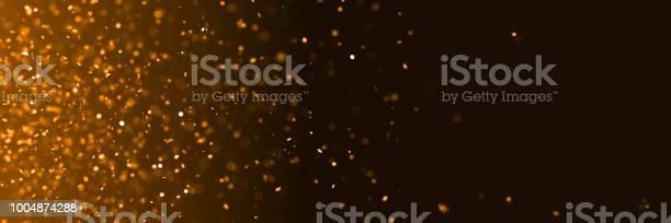 Twinkling metallic glitter in shades of orange in front of a dark picture id1004874288?b=1&k=6&m=1004874288&s=612x612&h=xk1mje7lv1nriadxgwgixuj 1tqgcr8fmb umml5zgi=
