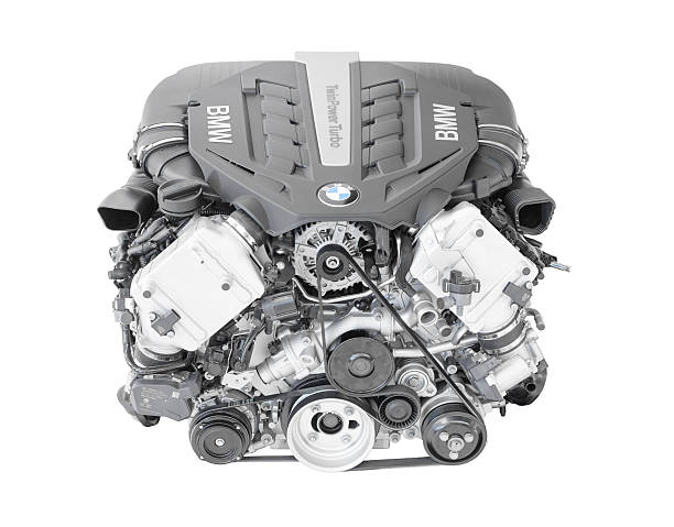 BMW TwinPower turbo V8-cylinder top-of-the-range petrol engine Munich, Germany - September 28, 2014: New modern flagship top model of irresistibly dynamic and incredibly efficient car engine. BMW TwinPower turbo V8-cylinder top-of-the-range petrol engine isolated on white. This image was obtained under studio conditions on a white background and has not been altered. bmw stock pictures, royalty-free photos & images