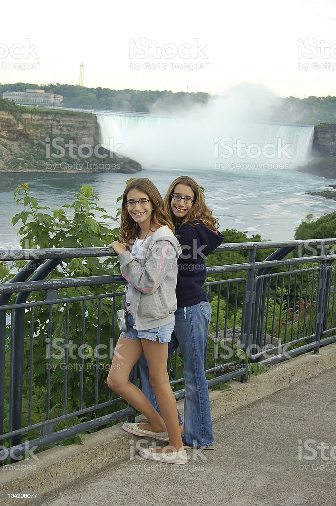 Twins at the falls stock photo