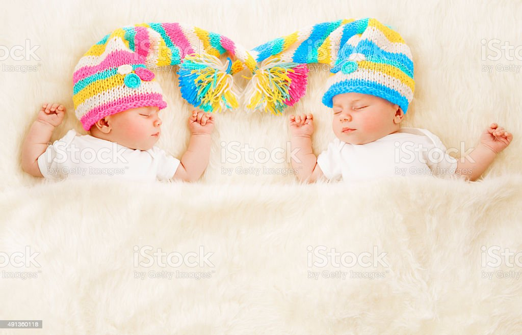 Twins Babies Sleep Hat, Newborn Kids Sleeping, New Born Girls stock photo