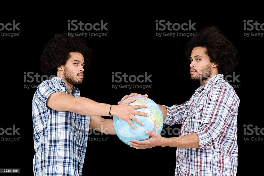 Twins holding a globe royalty-free 스톡 사진