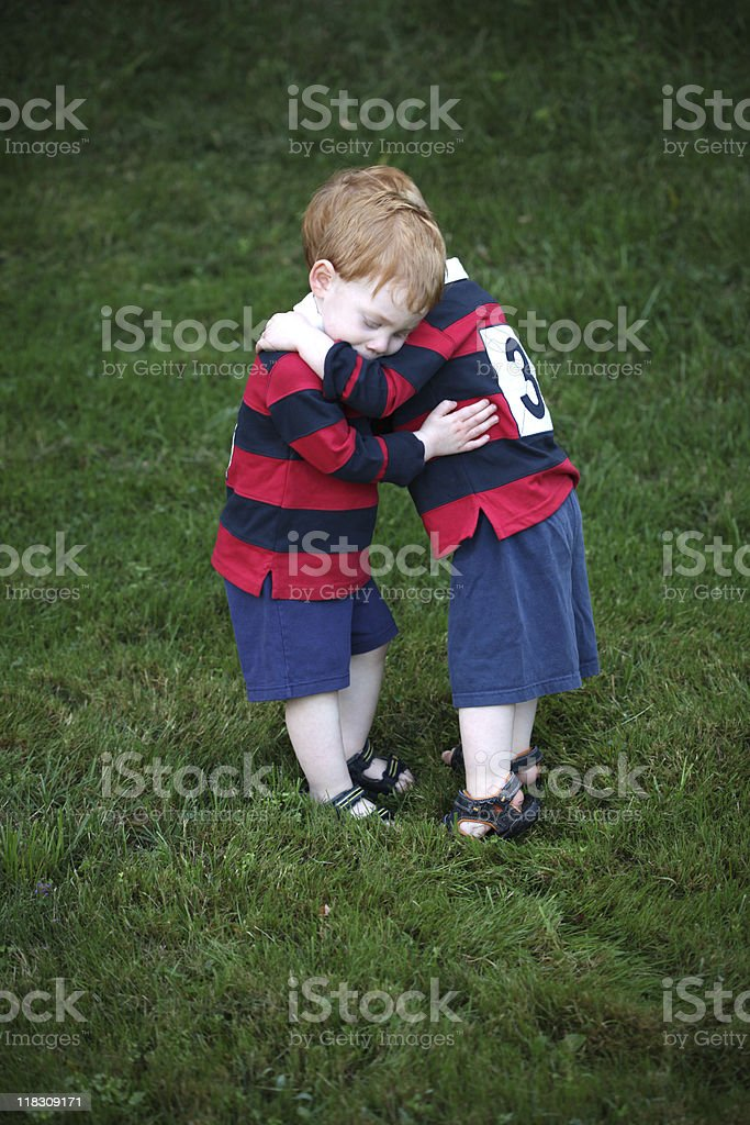 Twins hugging royalty-free stock photo
