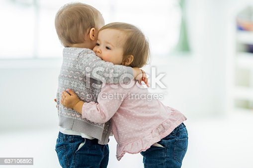 istock Twins Hugging 637106892