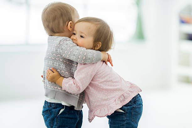 Twins Hugging stock photo