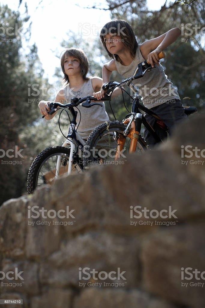 twins on bycicles outdoors royaltyfri bildbanksbilder