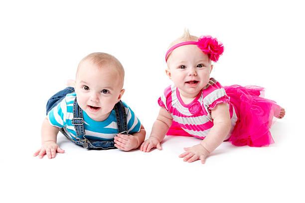 Twins on their tummy stock photo