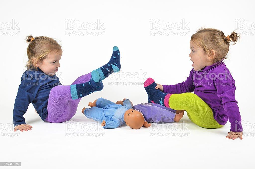 Twins playing stock photo