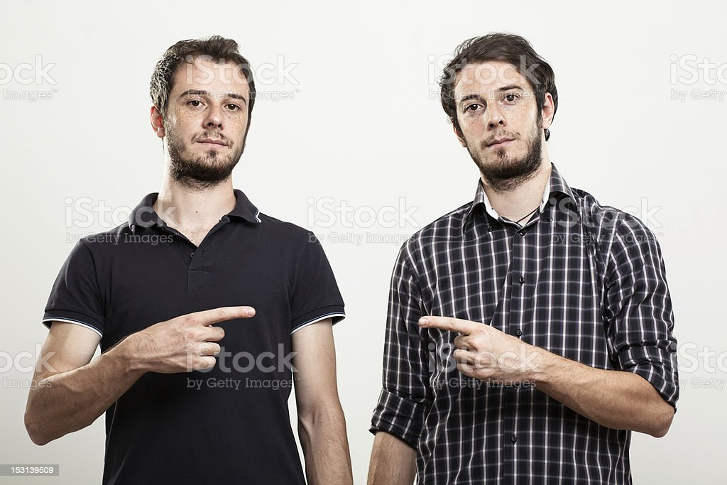 Twins Pointing Each Other stock photo