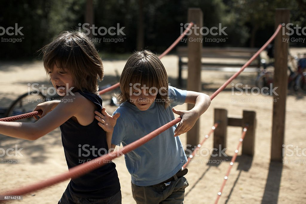 twins race on playground structure royalty-free stock photo