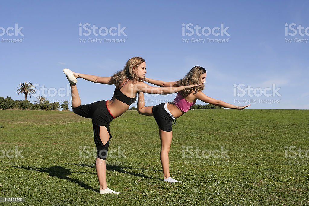 twins stretching royalty-free stock photo