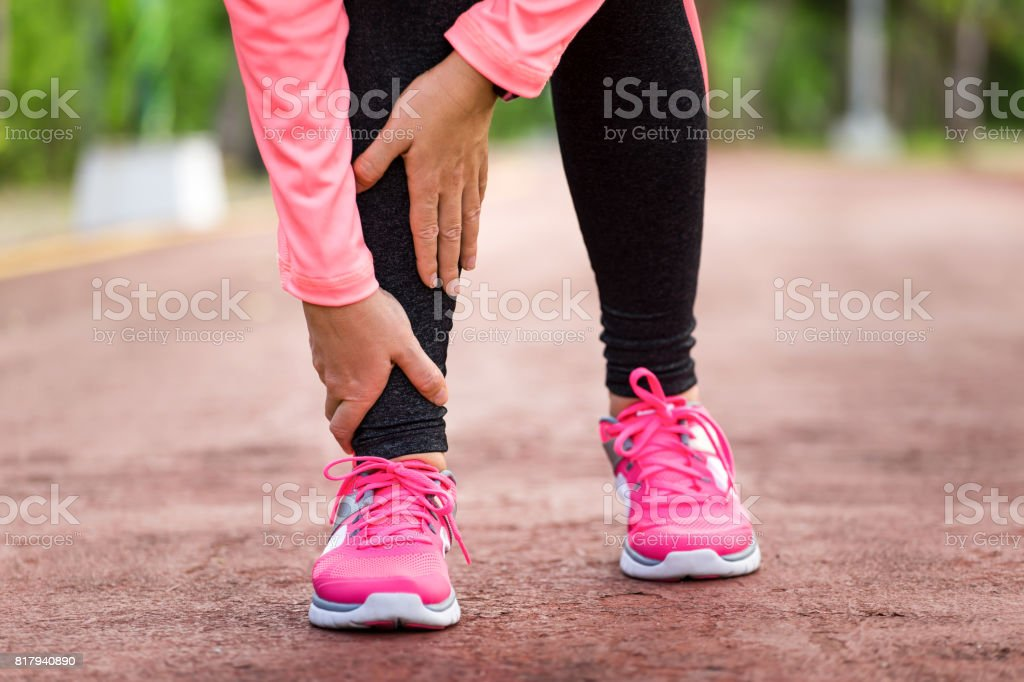 Twisted ankle pain stock photo