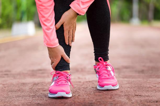 twisted ankle pain - caviglia foto e immagini stock