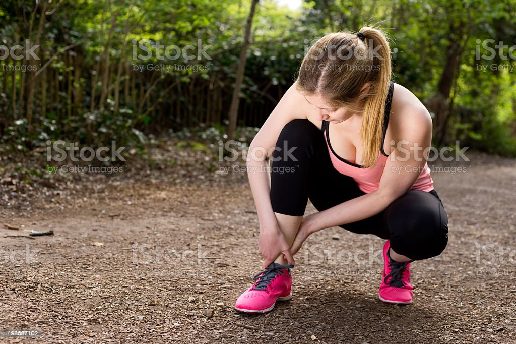 twisted ankle stock photo